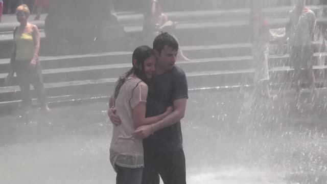 News video: Katie Holmes Gets Soaked in a T-Shirt While Playing in a Fountain