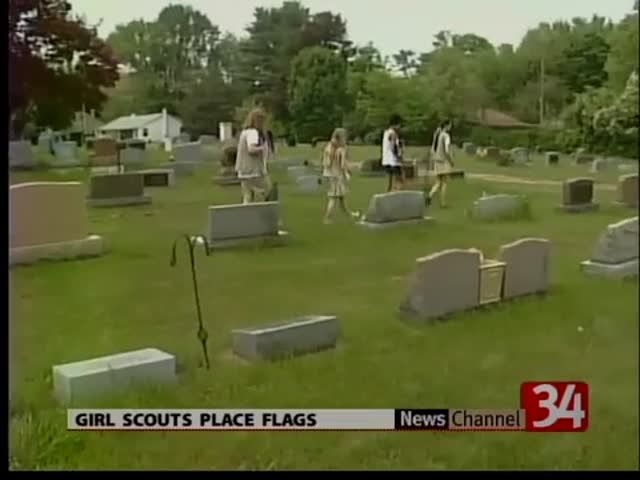News video: Girl Scouts Place Memorial Day Flags 05-22-13